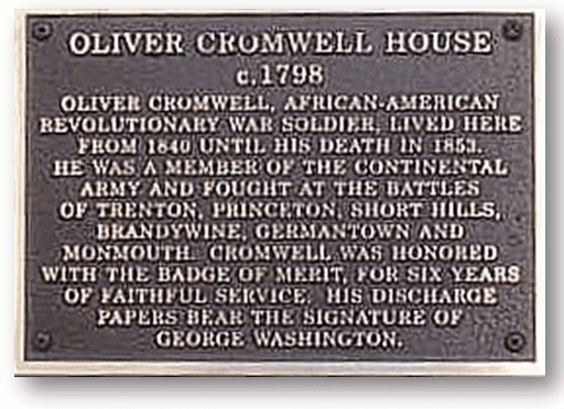 plaque indicating spot where African American Revolutionary War veteran Oliver Cromwell's house once stood