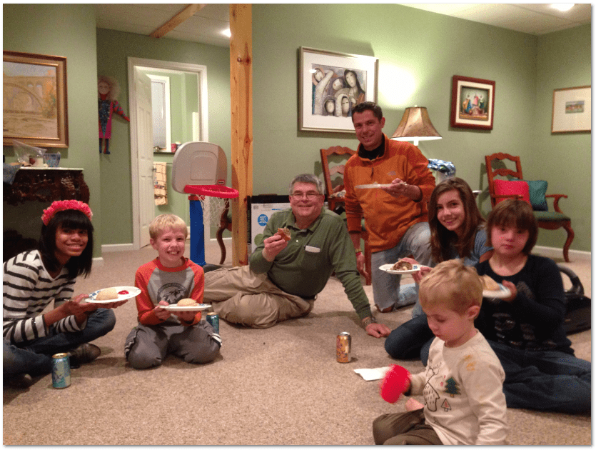 "photo of Scott Phillips and family members enjoying a ""pasty party"" over the holidays"