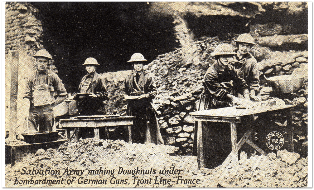 postcard showing Salvation Army women vounteers during WWI serving doughnuts to American troops