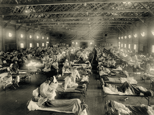 Photo: soldiers from Fort Riley, Kansas, ill with Spanish flu at a hospital ward at Camp Funston, Kansas. Credit: Otis Historical Archives, National Museum of Health and Medicine; Wikimedia Commons.