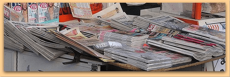 photo of newspapers at a newsstand