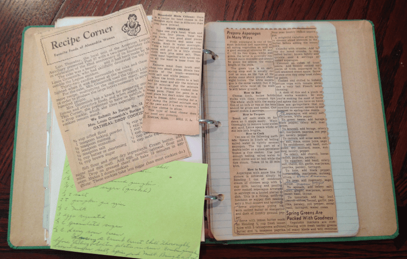 photo of a recipe book with old newspaper recipe clippings pasted in