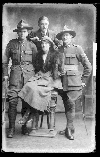 photo of three men and a woman from Ireland