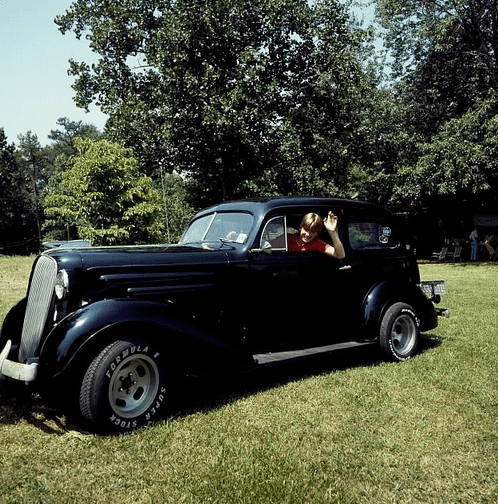 photo of a young driver in an old car at a family reunion in North Carolina