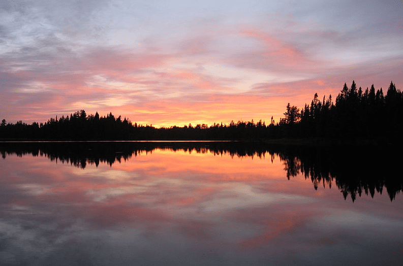 photo of a sunset over Pose Lake, a small lake accessible only by foot; Boundary Waters Canoe Area Wilderness, Minnesota