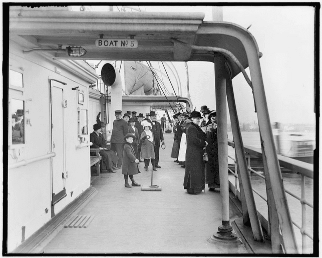 photo of passengers on the deck of the steamship Comus