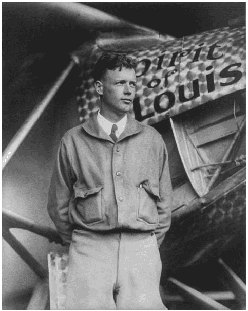 "photo of Charles Lindbergh standing in front of his plane ""Spirit of St. Louis"""