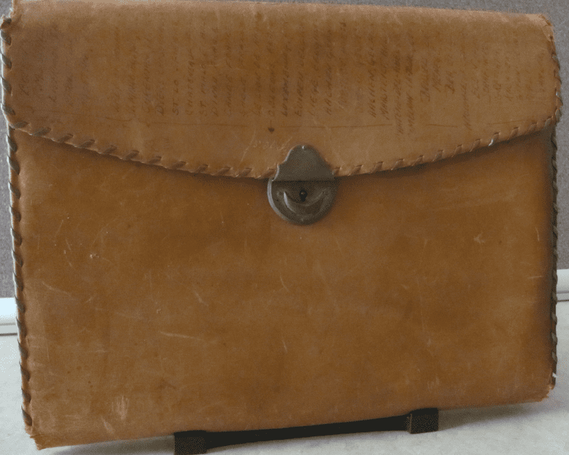 photo of a leather satchel carried by Scott Phillips's father across Europe during the fighting of WWII