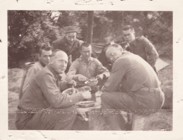 photo of Scott Phillips'sfather having lunch somewhere in Normandy with his squad during WWII