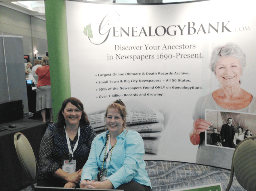 photo of Gena Philibert-Ortega and Duncan Kuehn staffing the GenealogyBank booth at the Jamboree genealogy conference