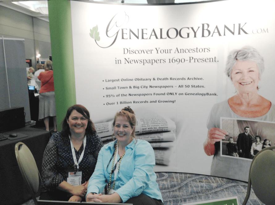 photo of Gena Philibert-Ortega and Duncan Kuehn staffing the GenealogyBank booth at the Jamboree genealogy conference