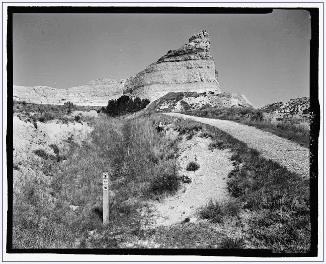 photo of the Oregon Trail, original cut and marker post; Scotts Bluff Summit Road, Gering, Scotts Bluff County, Nebraska (unknown date)