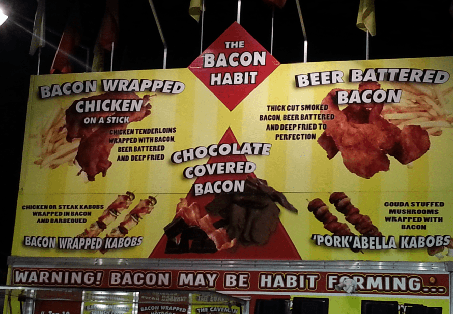 photo of a booth offering chocolate-covered bacon at the California State Fair