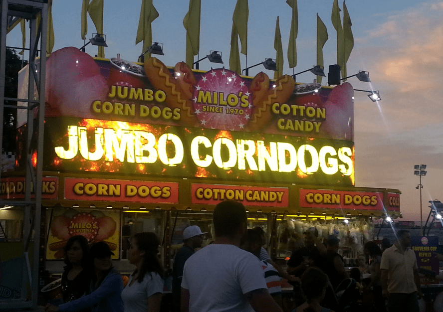 photo of a booth offering corn dogs and cotton candy at the California State Fair