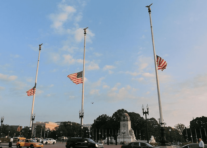 photo of American flags flying at half staff on Columbus Circle, Washington, D.C., on Patriot Day 11 September 2013