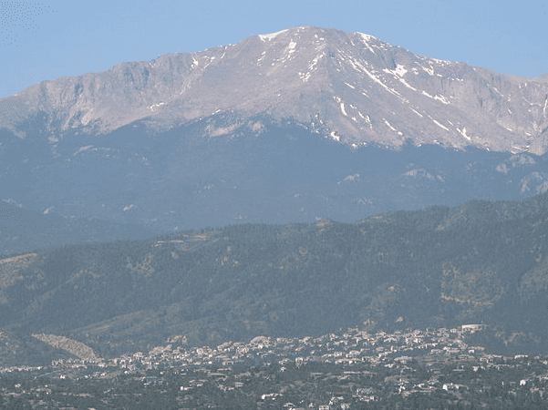 Photo: Pikes Peak, rising above present-day Colorado Springs, Colorado. Credit: Huttarl; Wikimedia Commons.