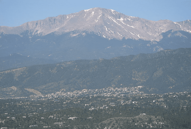 photo of Pikes Peak, rising above present-day Colorado Springs, Colorado