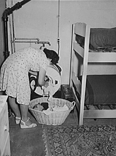 photo of a maid doing laundry, San Diego, California, 1941