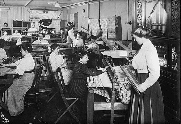 photo of women weavers at work, c. 1910