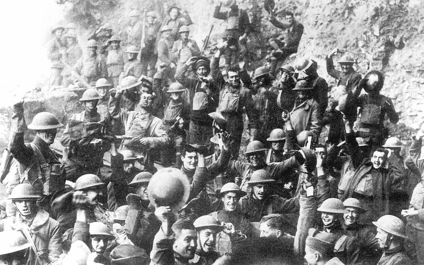 photo of American soldiers of the U.S. 64th Regiment, 7th Infantry Division, celebrating the news of the Armistice, 11 November 1918