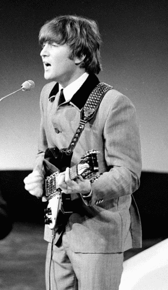 photo: ofJohn Lennon performing with the Beatles in 1964