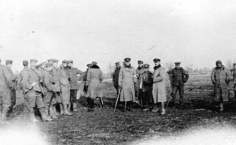 photo of British and German troops meeting in No-Man's Land during the WWI Christmas truce of 1914