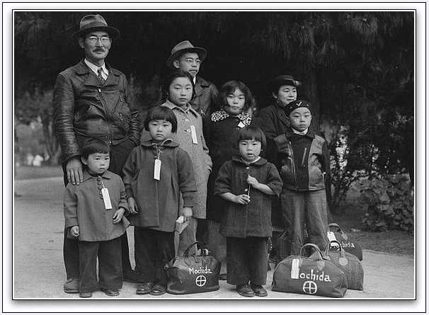 photo of the Mochida family awaiting the evacuation bus to Japanese American relocation camps during WWII