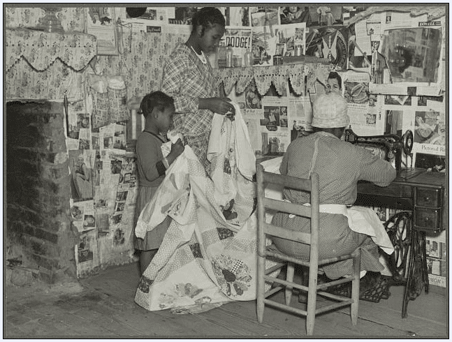 photo of Jorena Pettway sewing a quilt, Gees Bend, Alabama, c. 1937