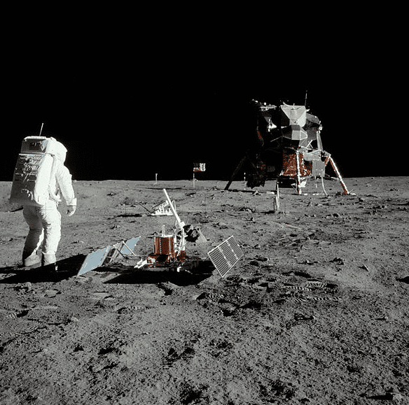 "photo of astronaut ""Buzz"" Aldrin on the Moon's surface, with the lunar module ""Eagle"" in the background"
