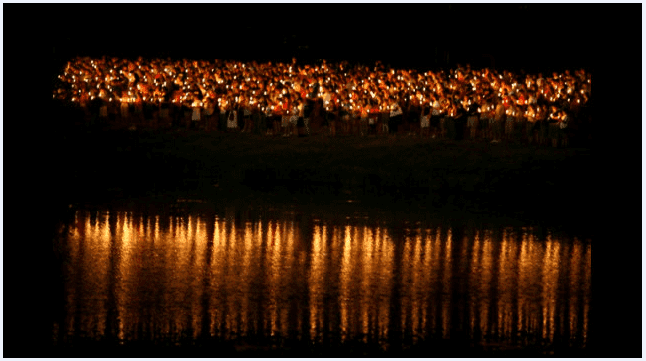 photo of candles lit on a wharf