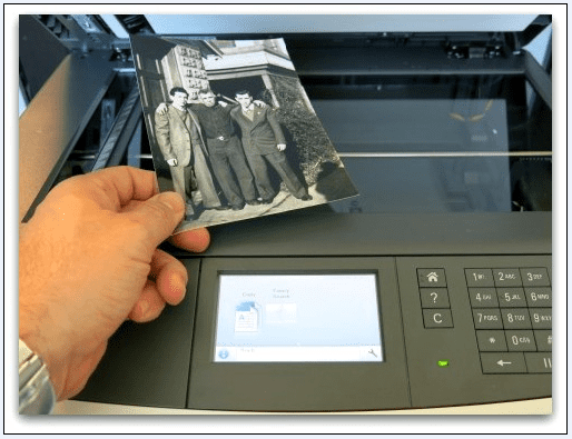 photo of an old photograph being scanned