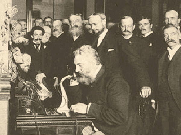 Photo: Alexander Graham Bell on the telephone in New York (calling Chicago) in 1892. Credit: U.S. Library of Congress, Prints and Photographs Division.