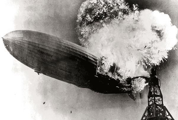 "Photo: the dirigible ""Hindenburg"" catching fire on 6 May 1937 at Lakehurst Naval Air Station in New Jersey. Credit: Gus Pasquerella; Wikimedia Commons."