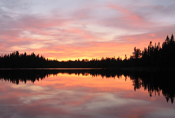Photo: sunset over Pose Lake in the Boundary Waters Canoe Area Wilderness, Minnesota. Credit: R27182818; Wikimedia Commons.