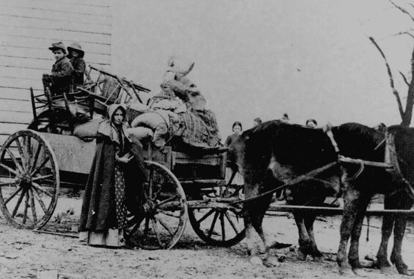 Photo: a refugee family during the Civil War leaving a war area with belongings loaded on a cart. Credit: National Archives.