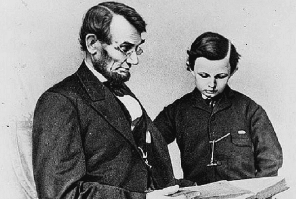 Photo: Abraham Lincoln and his son Tad looking at an album of photographs, 9 February 1864. Credit: Anthony Berger; Library of Congress, Prints and Photographs Division.
