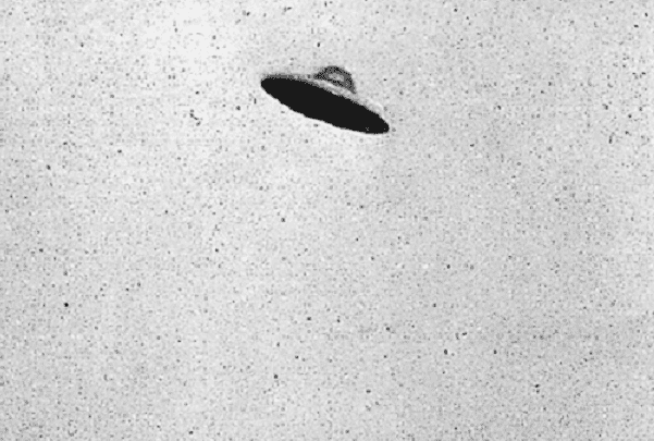 Photo: an alleged UFO over Passaic, New Jersey, taken on 30 July 1952. Credit: George Stock; Wikimedia Commons.