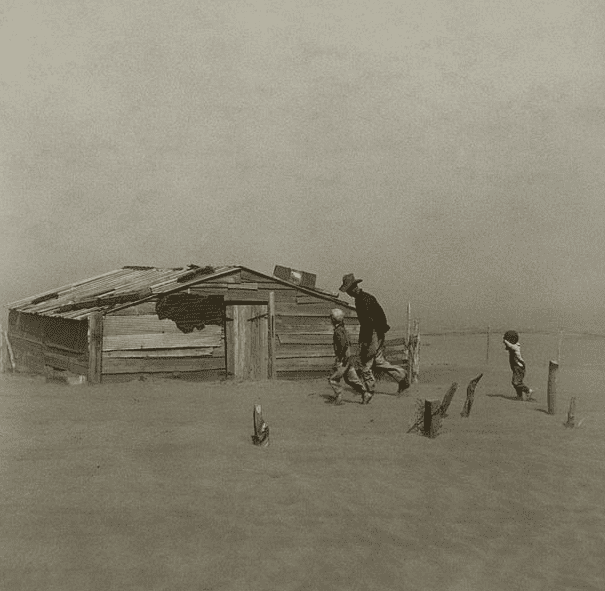 Photo: a farmer and his sons walking in the face of a dust storm, Cimarron County, Oklahoma, April 1936