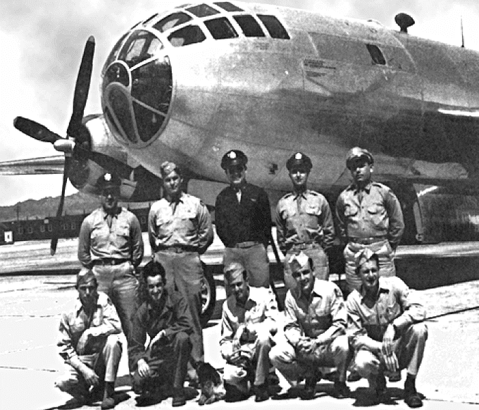 "Photo: the Bockscar and its crew, who dropped the ""Fat Man"" atomic bomb on Nagasaki, Japan, on 9 August 1945"