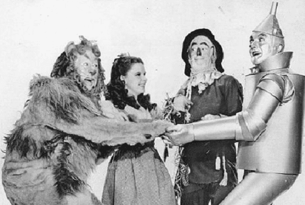 "Photo: publicity photo of American entertainers (L–R) Bert Lahr, Judy Garland, Ray Bolger, and Jack Haley from ""The Wizard of Oz."" Credit: NBC Television Network; Wikimedia Commons."