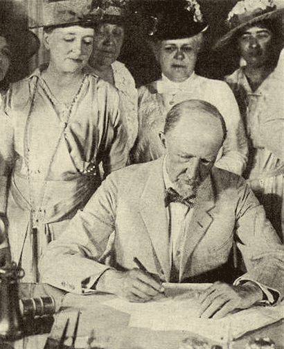 Photo: Speaker of the House of Representatives Gillett signing the suffrage bill after it had been passed by the Senate, 25 June 1919