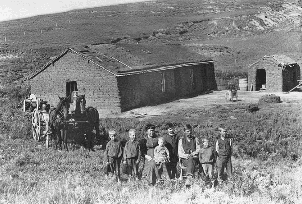 Photo: a farm family poses outside their sod house in eastern Custer County, Nebraska, c. 1888. Credit: U.S. Department of Agriculture; Wikimedia Commons.