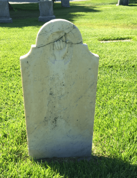 Photo: repaired stone tombstone damaged by vandals