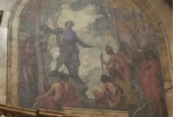 Photo: Puritan minister John Eliot leads Natick Indians in Christian Prayer, as depicted on the mural of the rotunda on the Massachusetts State House in Boston. Credit: Dajnez; Wikimedia Commons.