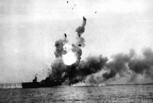 Photo: the escort carrier USS St. Lo (CVE-63) explodes off Samar after being hit by a kamikaze aircraft, 25 October 1944. Credit: Credit: U.S. Navy; Wikimedia Commons.