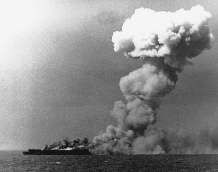Photo: the U.S. Navy light aircraft carrier USS Princeton (CVL-23) burning soon after she was hit by a Japanese bomb while operating off the Philippines on 24 October 1944