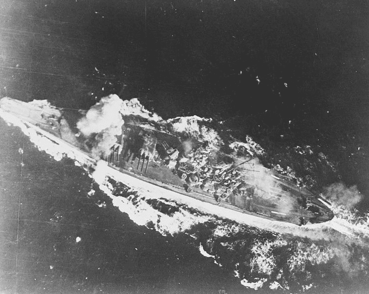 Photo: Japanese battleship Yamato is hit by a bomb near her forward 460mm gun turret during attacks by U.S. carrier planes, Battle of the Sibuyan Sea, 24 October 1944