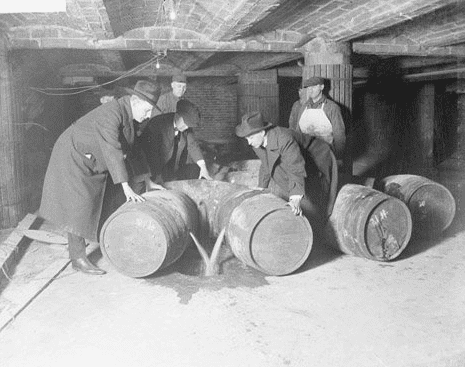 Photo: Prohibition agents destroying barrels of alcohol, 1921