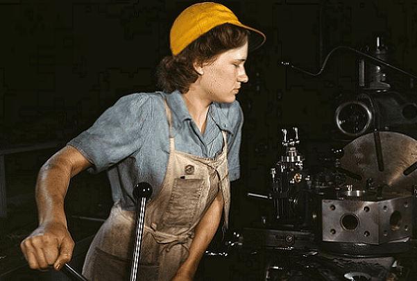 Photo: a woman working in a military aircraft factory in Fort Worth, Texas in 1942. Credit: Howard R. Hollem; U.S. Library of Congress, Prints and Photographs Division.