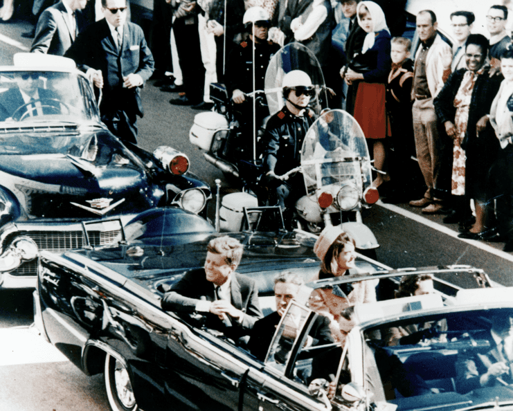 Photo: President Kennedy in the limousine in Dallas, Texas, on Main Street, minutes before the assassination. Also in the presidential limousine are Jackie Kennedy, Texas Governor John Connally, and his wife, Nellie, 22 November 1963